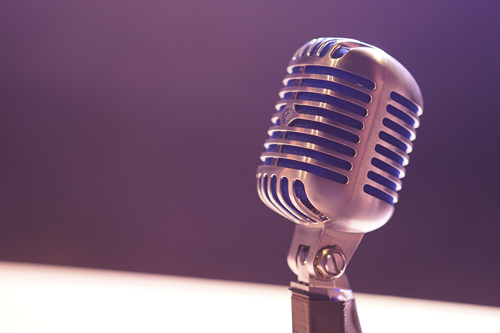 Photograph of an old-fashioned stand microphone.