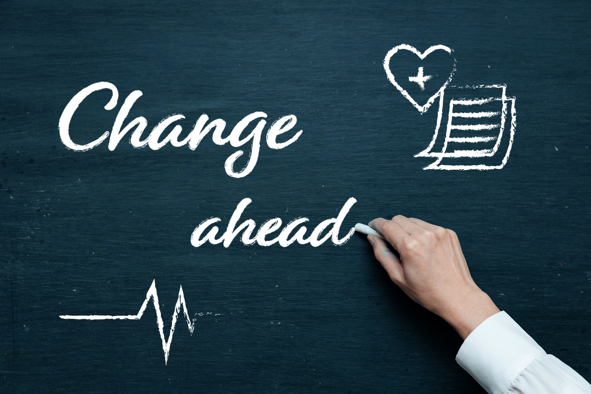 Graphic of a person's hand writing the phrase Change Ahead on a blackboard.