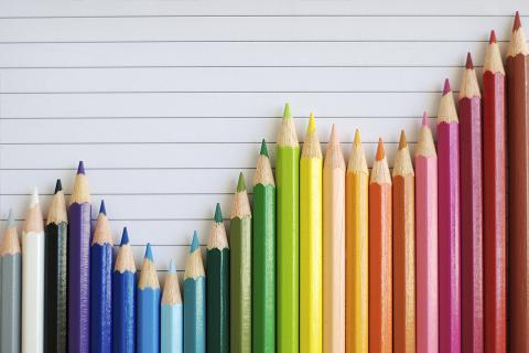 A chart formed from a rainbow of colored pencils