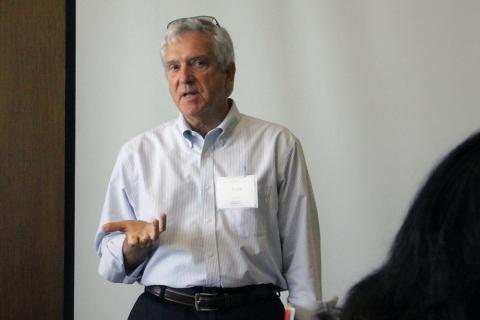 Photograph of Tom Eversole speaking to a group.
