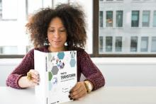 Image of woman reading the Time to Transform toolkit