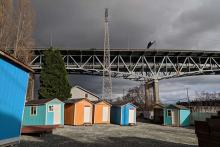 A photograph of a row of tiny houses.