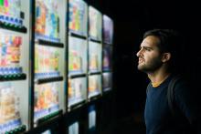 man-staring-at-vending-machines
