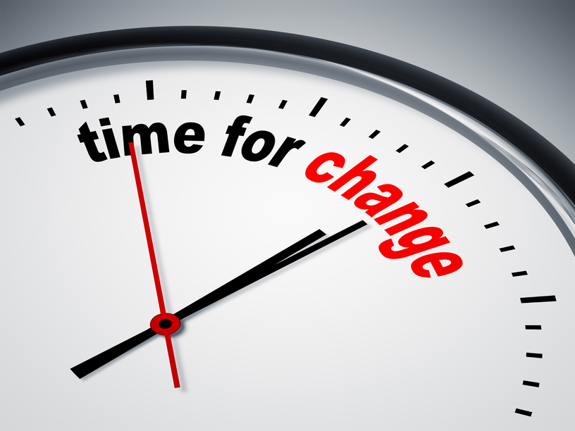 "Graphic of a clock face with the words, ""time for change"" printed on it."