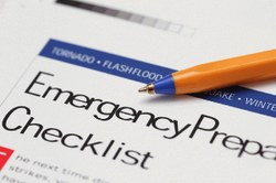 Photograph of a pen resting on an Emergency Preparedness Checklist.