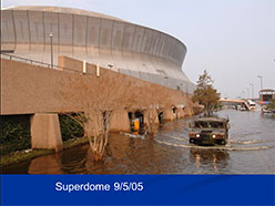 Photograph of the Superdome surrounded by flood waters.
