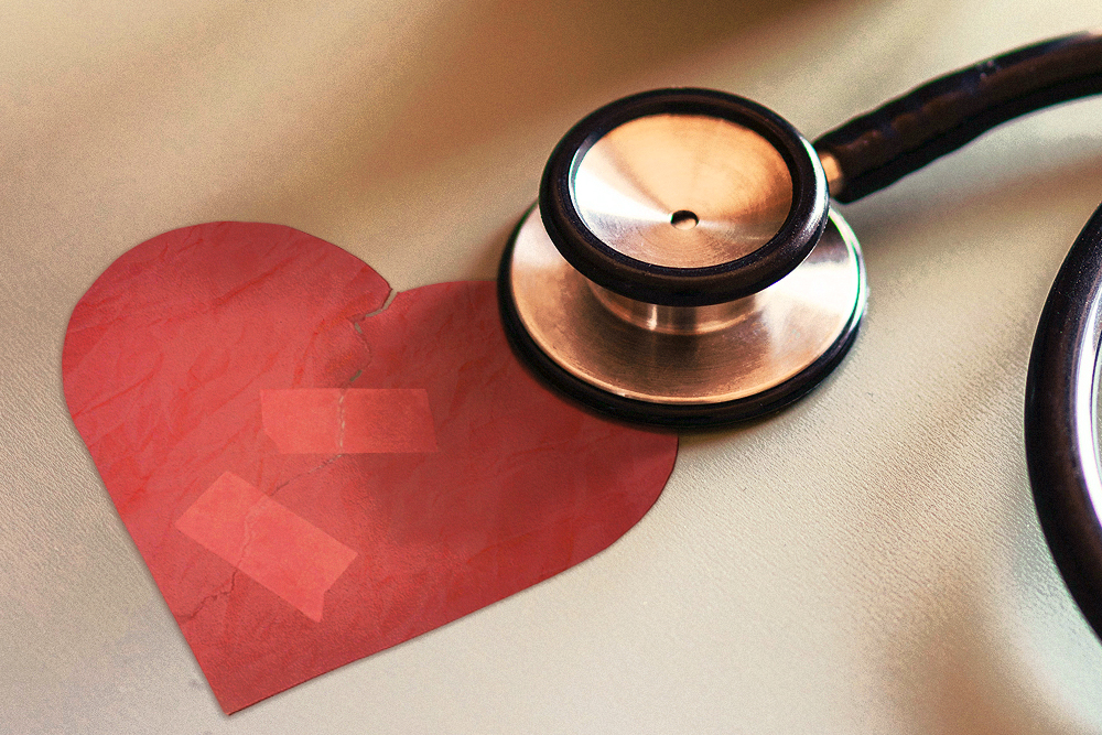 Photograph of a stethoscope resting on a hand-drawn heart.