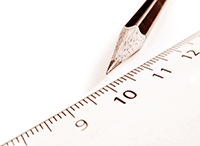 Photograph of a pencil next to a ruler.